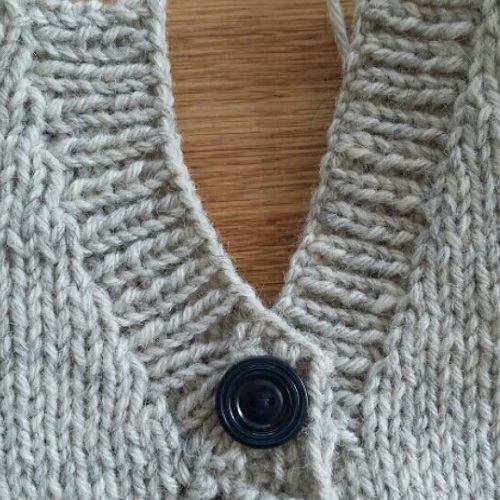 Close up of v-neck finish - cardigan